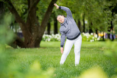 Senior woman doing sport in park Royalty Free Stock Photos