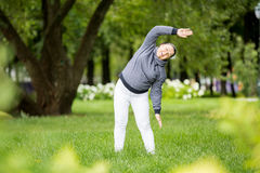 Senior woman doing sport in park Stock Photography