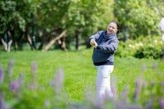 Senior woman doing sport in park Stock Image