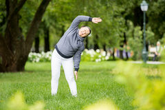 Senior woman doing sport in park Stock Photo