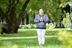 Senior woman doing sport in park Stock Images