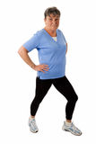Senior woman doing stetching exercises Royalty Free Stock Photo