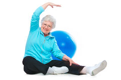 Senior woman doing stretching exercises Stock Image