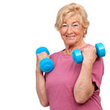 Senior woman doing workout. Portrait of healthy senior woman doing workout with weights.Isolated on white Stock Images