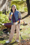 Senior woman doing yard work stock image