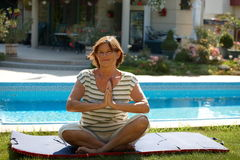 Senior woman doing yoga Stock Images