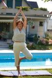 Senior woman doing yoga Stock Photography