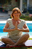 Senior woman doing yoga Stock Photography