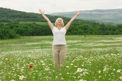 Senior woman doing yoga exercises Royalty Free Stock Image