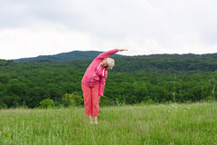 Senior woman doing yoga exercises Royalty Free Stock Photography