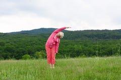 Senior woman doing yoga exercises Royalty Free Stock Photography