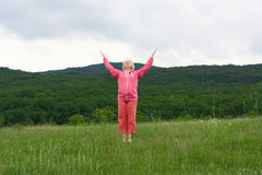 Senior woman doing yoga exercises Stock Photo