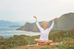 Senior woman doing yoga exercises Royalty Free Stock Photo