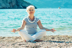Senior woman doing yoga exercises Royalty Free Stock Photo