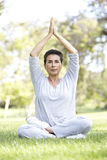 Senior Woman Doing Yoga In Park Stock Image