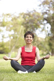 Senior Woman Doing Yoga In Park Stock Photos