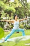Senior woman doing yoga at park Royalty Free Stock Image