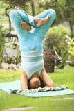 Senior woman doing Yoga practice Stock Photo