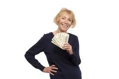 Senior woman with dollars Royalty Free Stock Photo