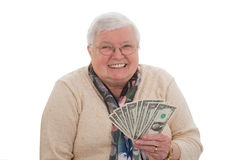 Senior woman with dollars - horizontal format Royalty Free Stock Photography