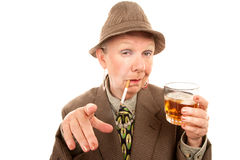 Senior woman in drag with cigarette and alcohol Stock Photos