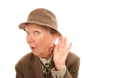 Senior woman in drag listening Royalty Free Stock Photo