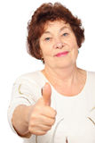 Senior woman in drees show big finger stock photography