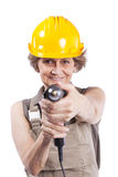 Senior woman with a drill tool Stock Photography