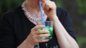 Senior Woman Drinking Cocktail stock video