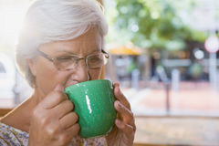 Senior woman drinking coffee Royalty Free Stock Images