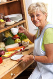 Senior woman drinking coffee. In her kitchen Stock Photo