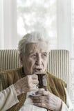 Senior woman drinking coffee Royalty Free Stock Photo