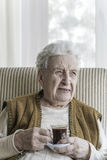 Senior woman drinking coffee Royalty Free Stock Image