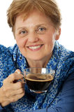 A senior woman drinking a cup of coffee Royalty Free Stock Photo