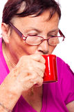 Senior woman drinking espresso Royalty Free Stock Image