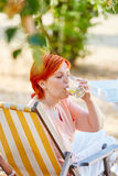 Senior woman drinking a glass of water Royalty Free Stock Photography