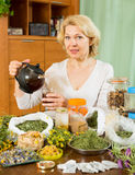 Senior  woman drinking herbal tea Stock Images