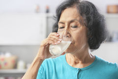 Senior woman drinking milk Stock Image