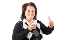 Senior woman drinking milk Stock Images