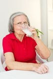 Senior woman drinking milk Royalty Free Stock Photography