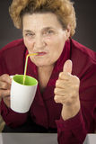 Senior woman drinking Royalty Free Stock Photography