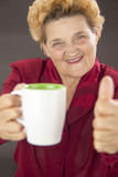 Senior woman drinking Stock Photography