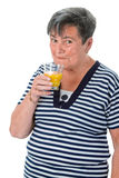 Senior woman drinking orange juice Royalty Free Stock Images