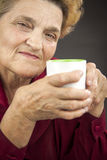 Senior woman drinking Royalty Free Stock Images