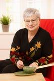 Senior woman drinking tea Royalty Free Stock Photos