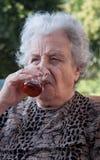 Senior woman drinking tea Stock Photography