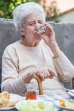 Senior woman drinking tea Royalty Free Stock Image