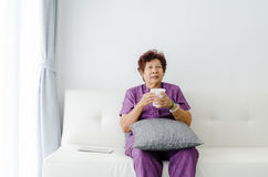 Senior woman drinking tea at home. Royalty Free Stock Image