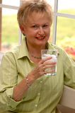 Senior woman drinking water Royalty Free Stock Images