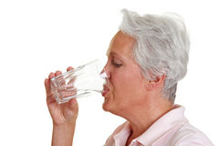 Senior woman drinking water Stock Photography